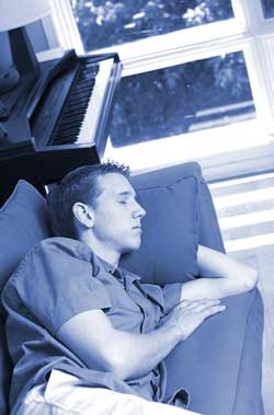 Teen with delayed sleep phase syndrome sleeping on the couch