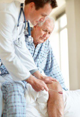 A patient with restless leg syndrome being seen by his doctor