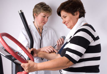 A doctor helping a woman with her sleep apnea and weight loss.